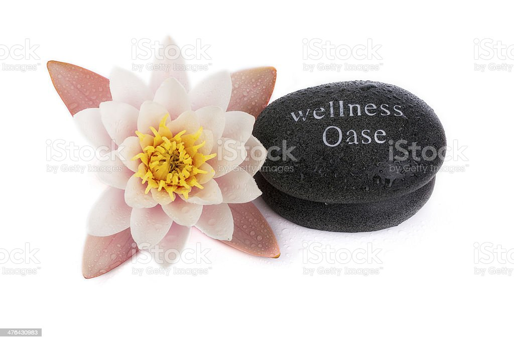 Lily with massage stones in black royalty-free stock photo