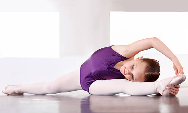 limbering up before the recital - leotard stock pictures, royalty-free photos & images