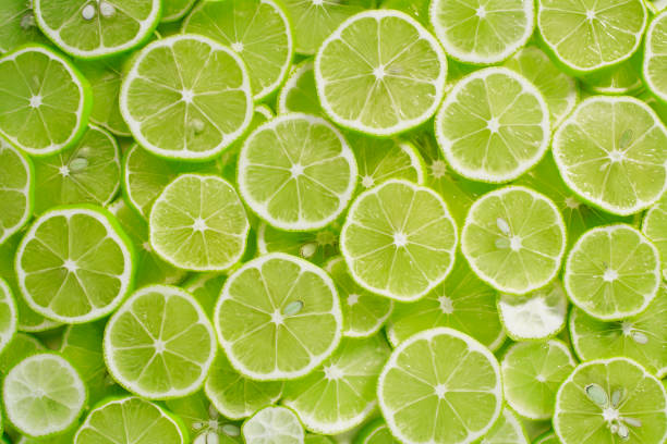 Lime Background Lime Background lime stock pictures, royalty-free photos & images