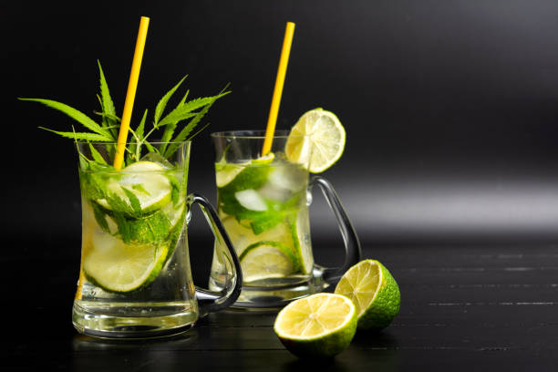Lime cocktail with marijuana in a glass