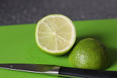 Juicy green lime cut in two. Looking very fresh and tasty.  Taken in the UK in Derbyshire.