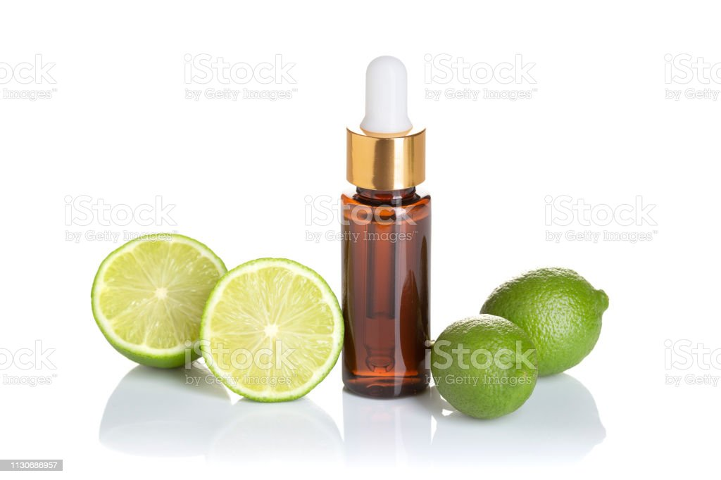 Lime essential oil isolated on white background stock photo