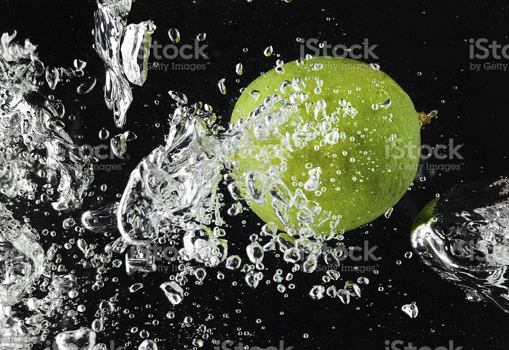 Lime (lemon)  falling in water on black royalty-free stock photo