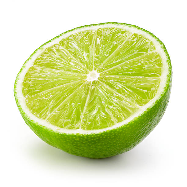 lime fruit. half isolated on white background - lime stock photos and pictures