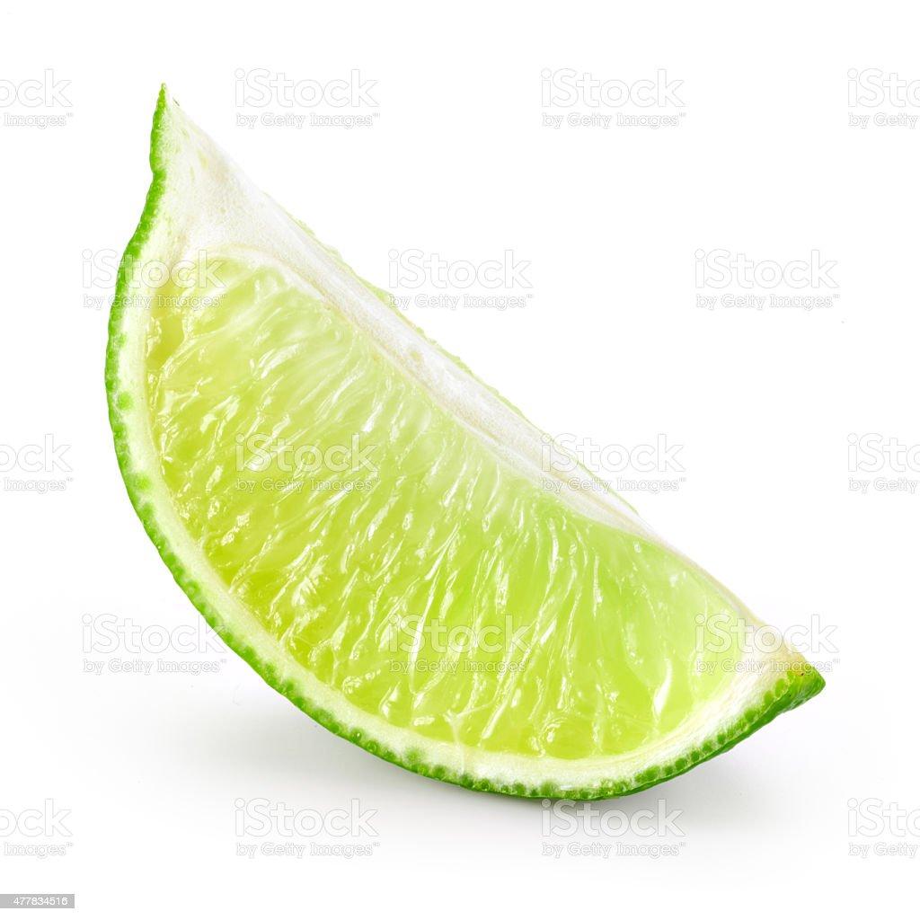 Lime fruit. Slice isolated on white stock photo