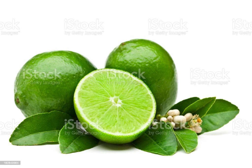 Lime fruits with leaves and flowers stock photo