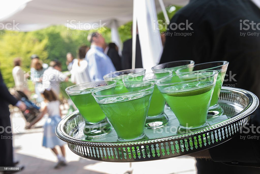 Lime Green Alcoholic Drinks Being Served by Waiter royalty-free stock photo