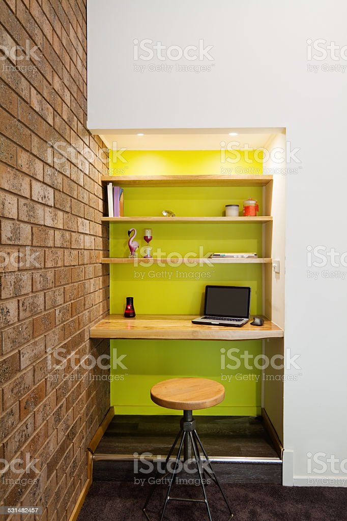 Lime green feature wall study nook in living room stock photo