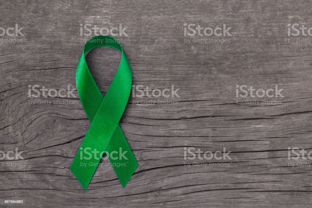 Lime Green ribbon for Lymphoma Cancer and mental health awareness raising support and help patient living with illness stock photo