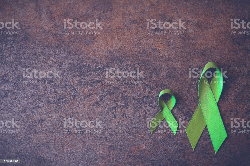 Lime Green Ribbons ,Lyme disease, Mental health awareness stock photo