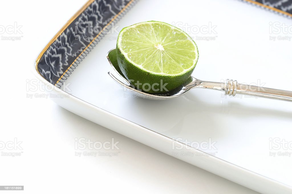Lime in the spoon royalty-free stock photo