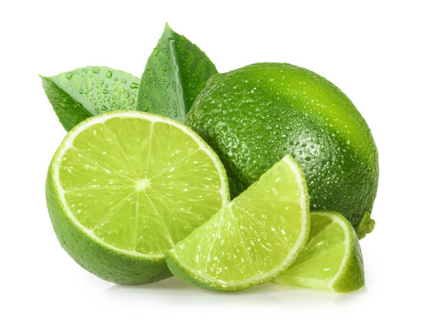 lime isolated on white background - limone foto e immagini stock
