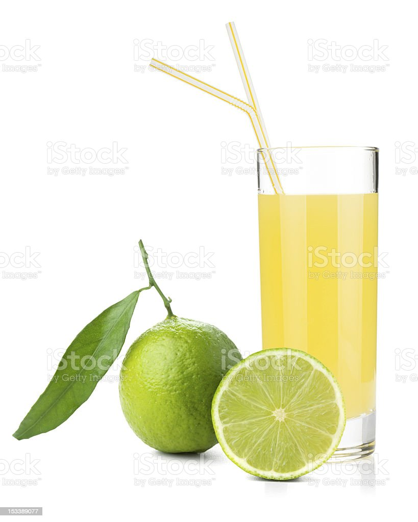 Lime juice glass with ripe limes stock photo