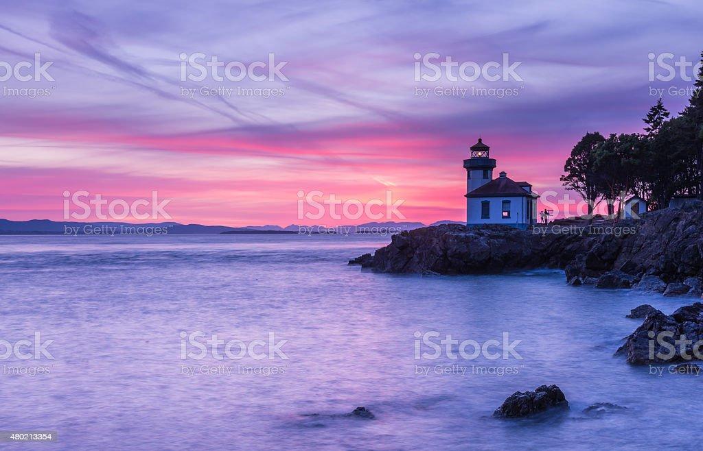 Lime Kiln Lighthouse at sunset stock photo