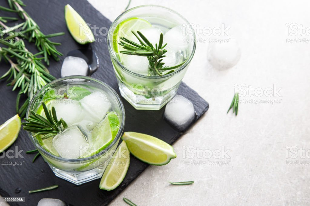 Lime Lemonade with rosemary and ice, selective focus stock photo
