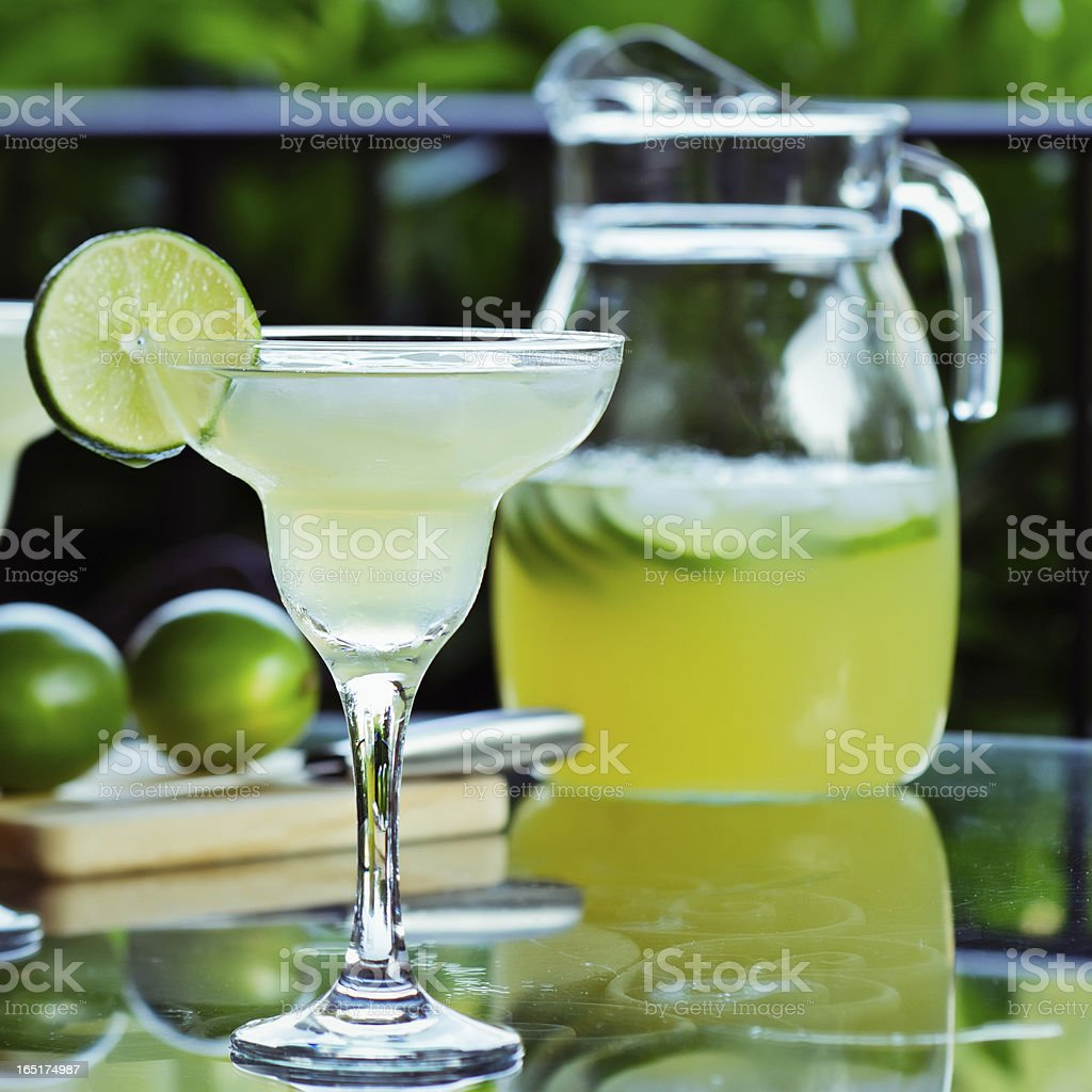 Lime margaritas with glass and pitcher stock photo