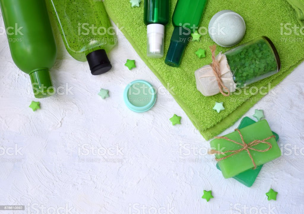 Lime mint composition beauty treatment products in green colors: shampoo, soap, bath salt, towel, oil. Various bath accessories. Items for the spa stock photo