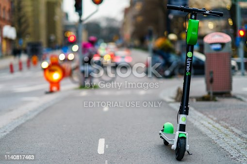 istock Lime Scooter ride by online app, they can any street on town Centre of Goteborg 1140817463