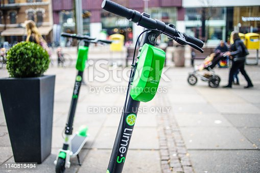 istock Lime Scooter ride by online app, they can any street on town Centre of Goteborg 1140818494