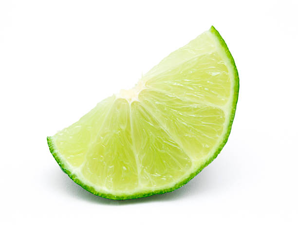 Lime Slice Lime Slice Isolated on White Background lime stock pictures, royalty-free photos & images