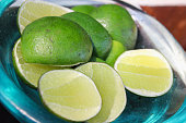 Close up lime slices in a glass plate