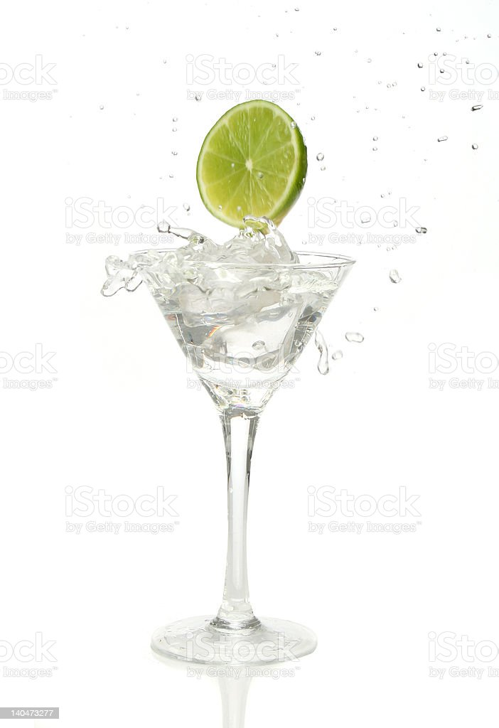 Lime splashing into a cocktail glass royalty-free stock photo