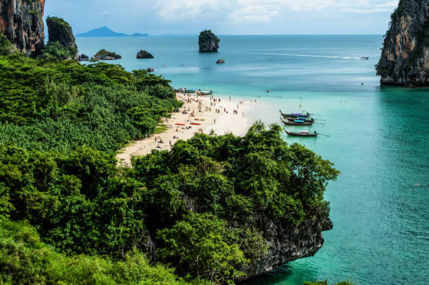 Lime Stone Formations and Beach seen from a Cave, Phra Nang, Railay Beach, Krabi, Thailand stock photo