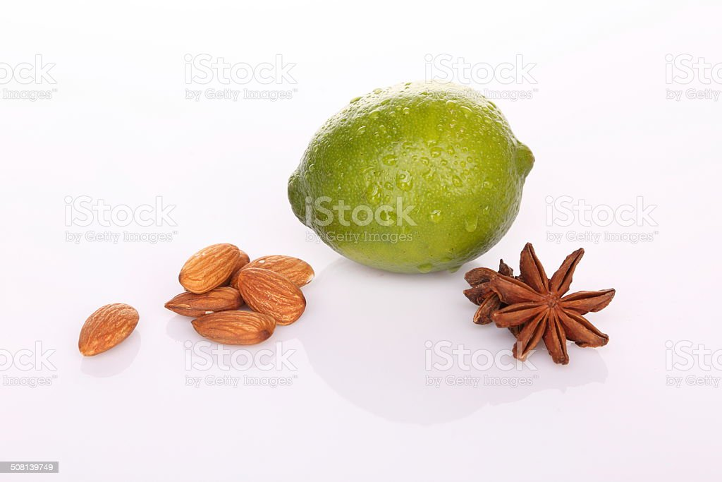 Lime with almond (nuts) and cardamom star stock photo