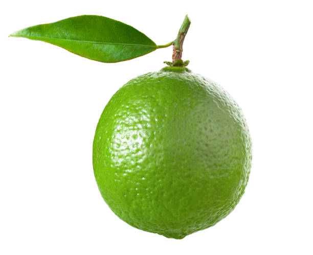 Lime with leaf isolated on white stock photo