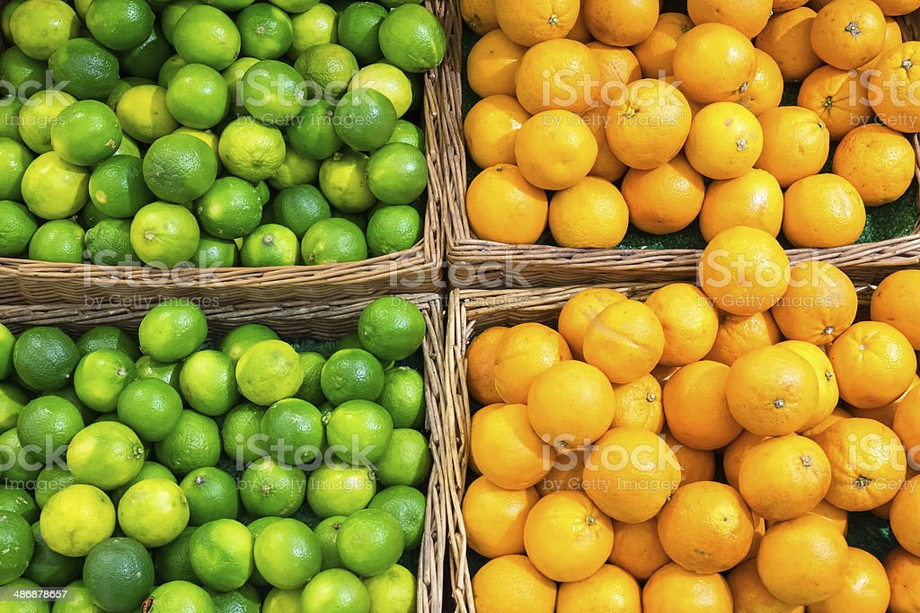 Limes and oranges stock photo