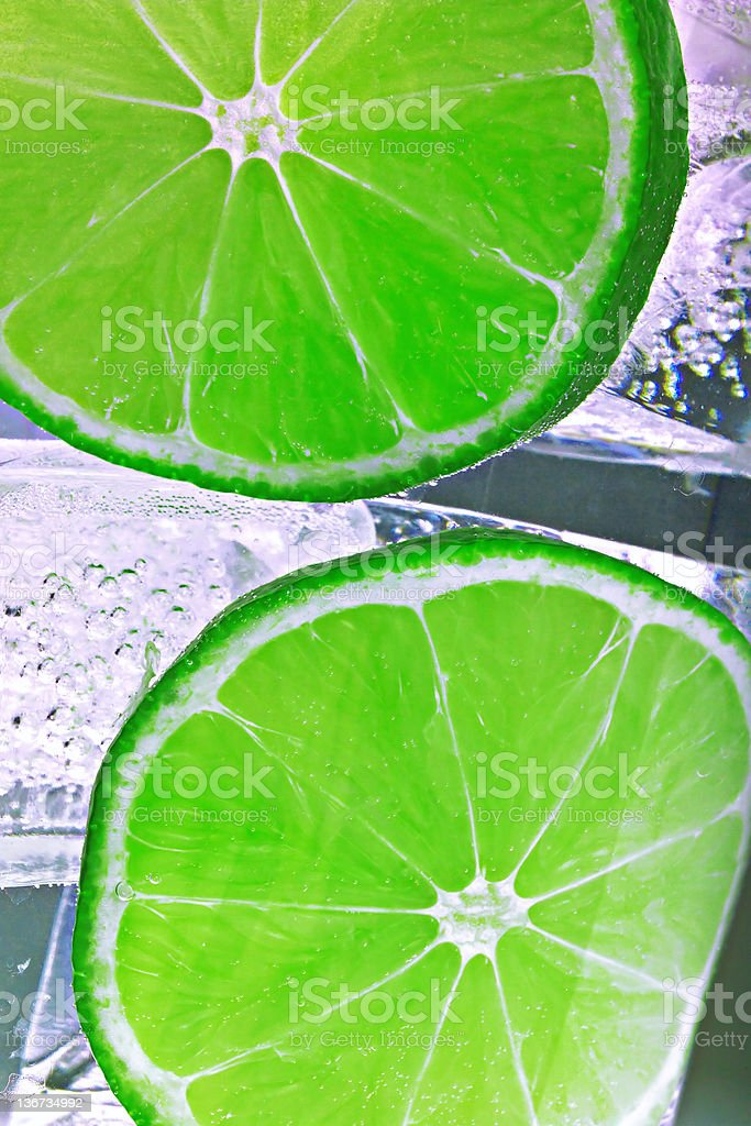 limes in ice water royalty-free stock photo