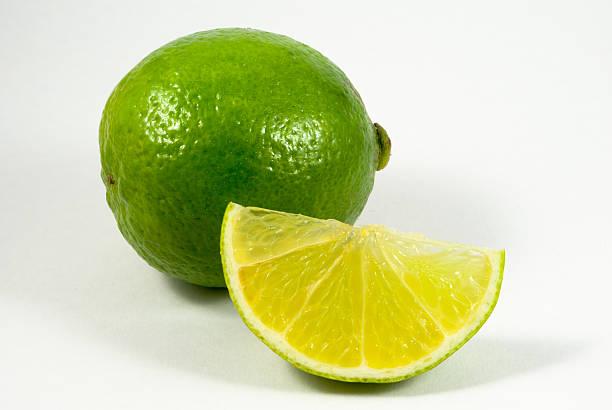 lemons Limes, mit Scheiben – Foto