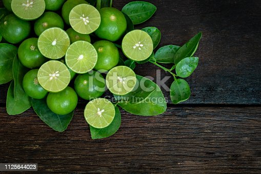 lime and limes slice on wooden table