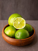 Fresh Limes in the wooden bowl