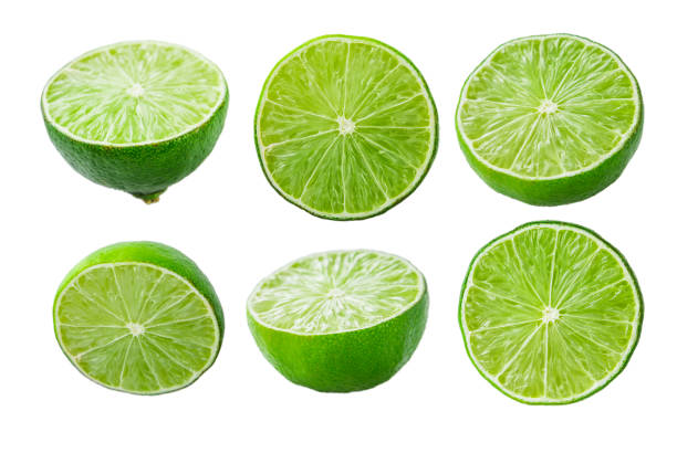 Limes slices on white background Collection of limes slices isolated on white background limoen stock pictures, royalty-free photos & images