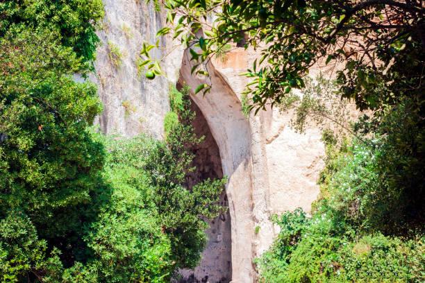 Limestone Cave Ear of Dionysius (Orecchio di Dionisio) with unusual acoustics - Syracuse, Sicily, Italy. stock photo