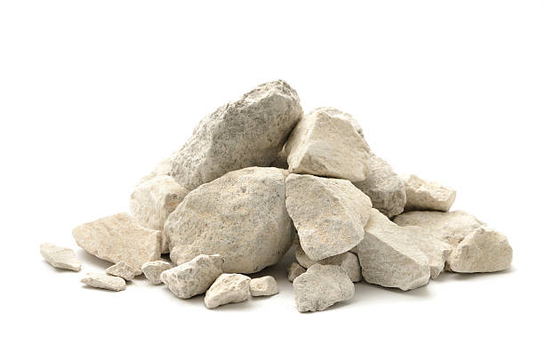 Limestone chippings Stone and dust (limestone) isolated on a white background. rock object stock pictures, royalty-free photos & images