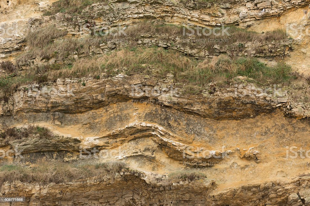 limestone geology rock layers in cliff stock photo