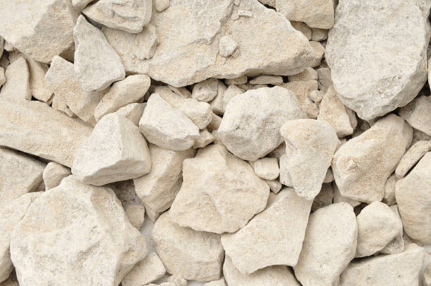 Limestone in background with rocks stock photo