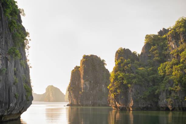 Limestone Karsts and Quiet Water in Lan Ha Bay, Vietnam stock photo