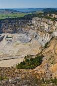 Limestone mine in Koneprusy, Czech Republic. Deep opencast mines leave great environmental impact.