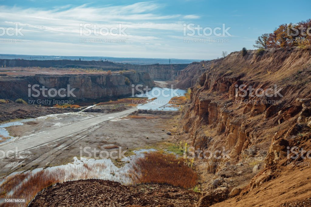 Limestone Mining In A Quarry With A Pond Stock Photo