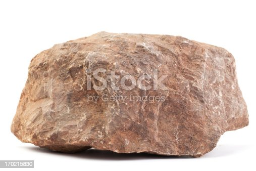 Big piece of stone isolated on white. Its longest size is appr. 30 cm (12 inch). The type of stone is red limestone.