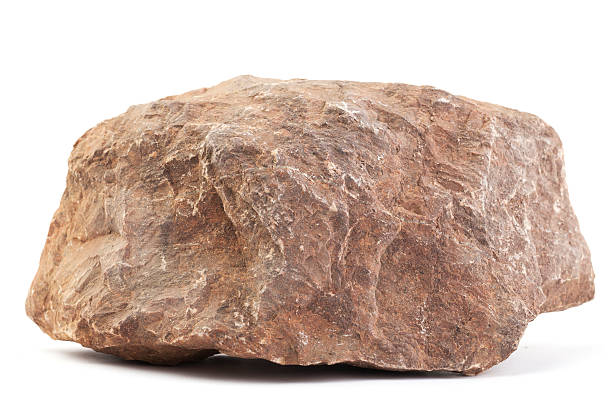 Limestone Big piece of stone isolated on white. Its longest size is appr. 30 cm (12 inch). The type of stone is red limestone. rock object stock pictures, royalty-free photos & images