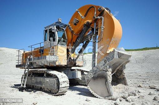 Limestone Quarry mine equipment. Excavator.