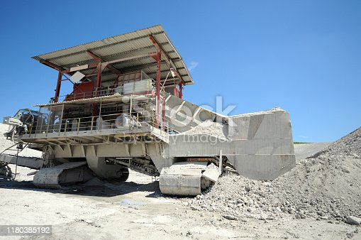 Limestone Quarry mine equipment. Excavator.