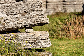 Two limestone rocks (karst erosion) with a pebble in the Regional Natural Park of Lessinia (Valle delle Sfingi), Veneto, Verona, Italy, Europe