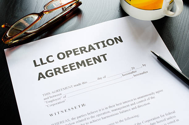 A limited liability company operation agreement with pen stock photo