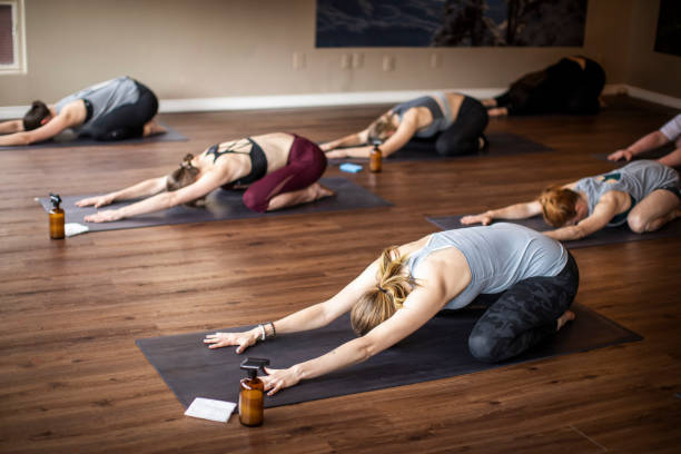 Limited people yoga class in studio during covid-19 pandemic.