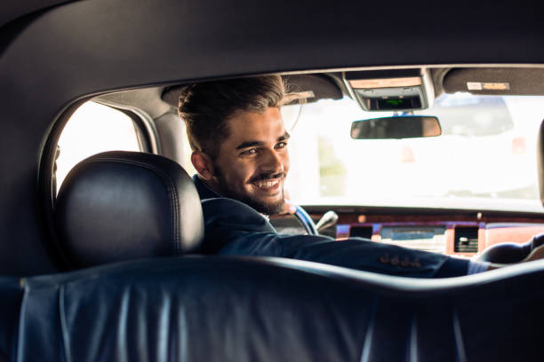 limo driver smiling - limousine service stock photos and pictures